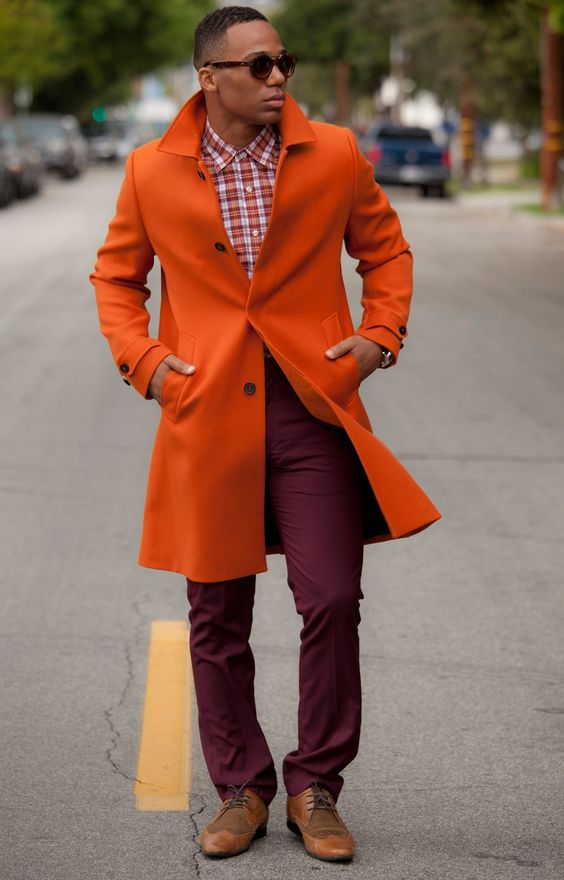 model wearing beautiful orange over coat